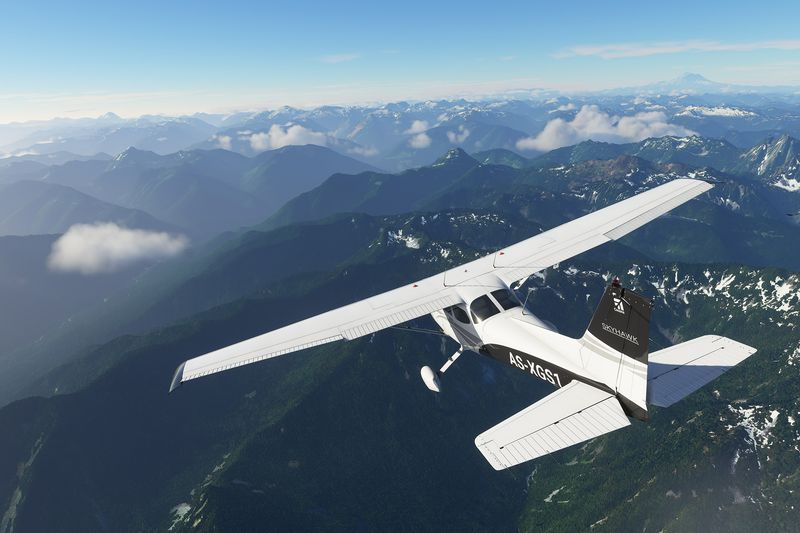 A Cessna 172 Skyhawk, complete with a Garmin G1000 Glass cockpit instrumentation, over mountains in the pre-alpha of Microsoft Flight Simulator. Captures in Sept. 2019 via Microsoft.