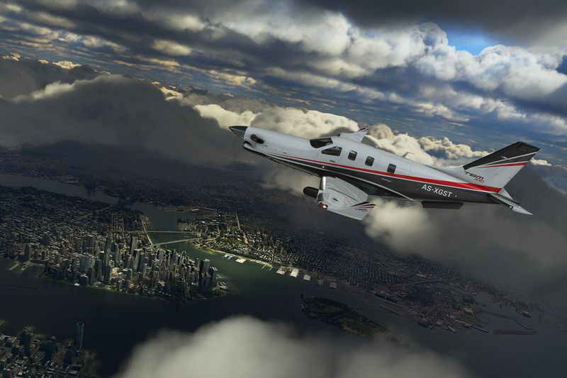 Multiple layers of clouds complex shadows over Manhattan as a single-engine turboprop flies through the frame from right to left.