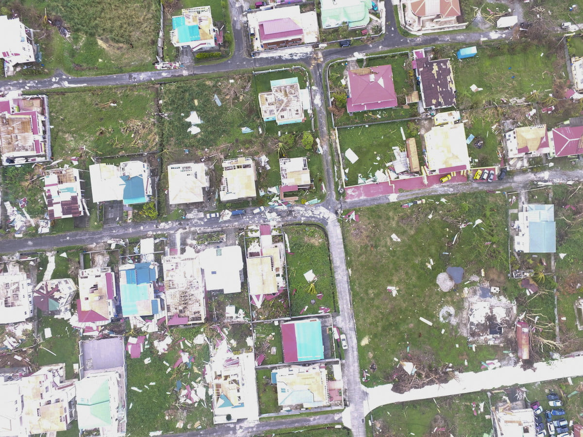 An aerial shot from a drone of damaged homes and land after Hurricanes Irma and Maria.