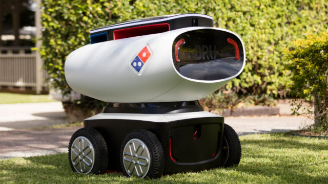 A pizza-delivering robot with a Domino's logo.