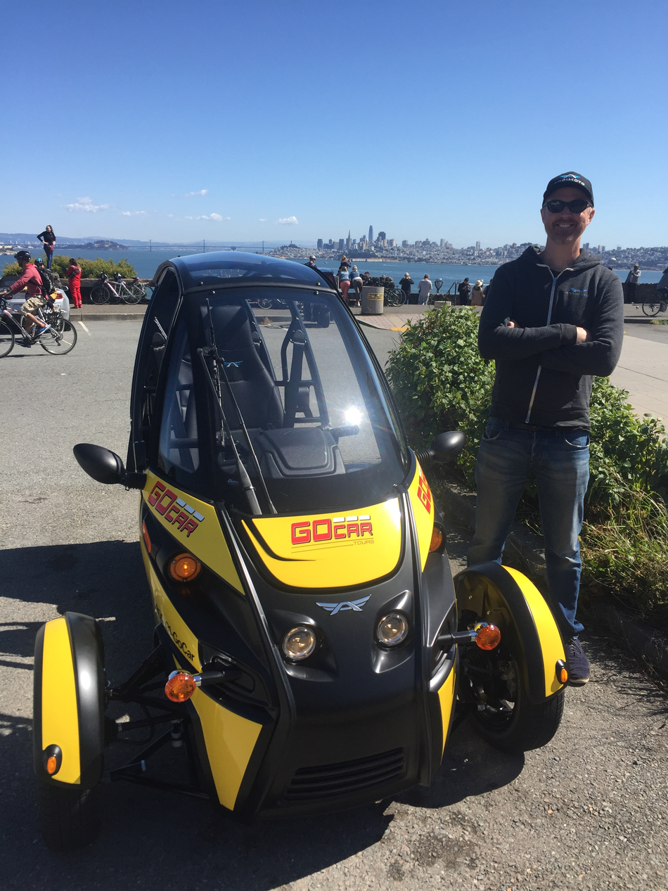 Arcimoto founder Mark Frohnmayer with the first electric GoCar.