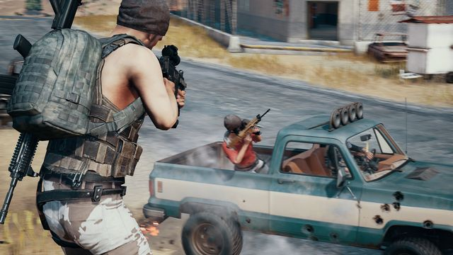 PlayerUnknown's Battlegrounds - a player fires into the bed of a truck from an elevated position