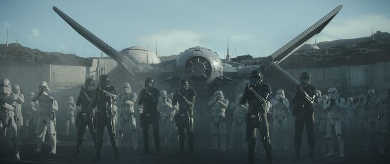 A squad of Death Troopers stands at the ready before Moff Gideon's modified TIE fighter in the public square on Navarro. From The Mandalorian season 1, episode 7.